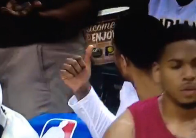 Paul George enjoys some popcorn on the bench